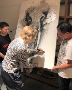 Carolyn-Kinder-Signing-Art-for-Charity-Event